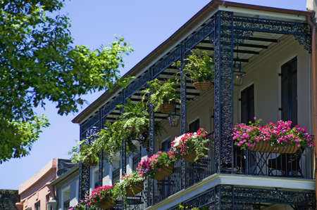 Decorative Iron Balcony in the French Quarter district of New Orleans, Louisiana Stok Fotoğraf