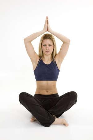 early 20s: Mujer en la meditaci�n practicante temprana del yoga 20s Foto de archivo