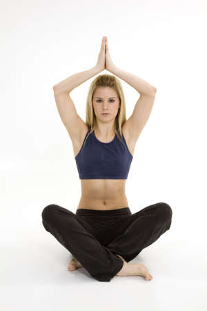Woman in early 20s practicing yoga meditation