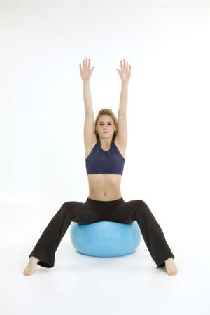 Model Release 376  Young blonde woman exercising on a white background photo