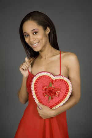 Model Release 379 African American woman posing on gray background in red lingerie with a Valentine heart Stock Photo - 789050