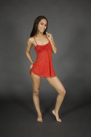 Model Release 379 African American woman posing on gray background in red lingerie Reklamní fotografie