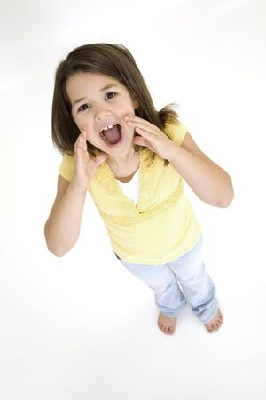 Five year old female child standing on white background shouting and wearing casual clothes