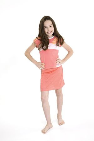 Eight year old female child standing on white background smiling wearing casual clothes