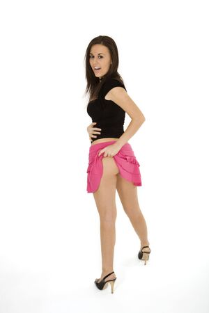 Very sexy Caucasian woman dresses pink mini skrit and standing on white background