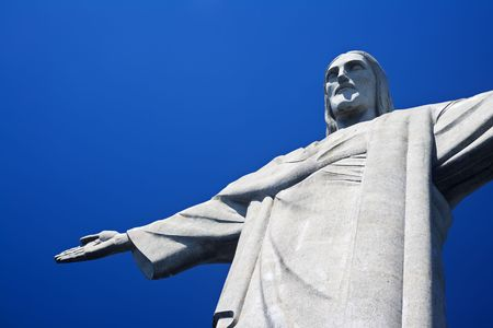 Christ the Redeemer on Corcovado Mountain, Rio de Janeiro  Brazil South America  The statue stands 38 m (125 feet) tall and is located at the peak of the 710-m (2330-foot) Corcovado mountain in the Tijuca Forest National Park, overlooking the city. As wel