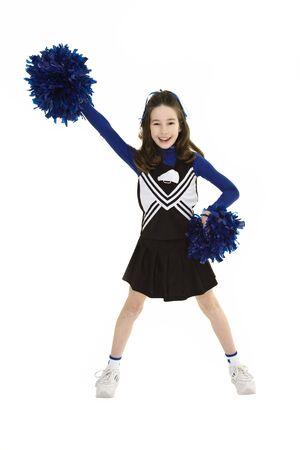 Tien jaar oude blanke meisje verkleed als cheerleader