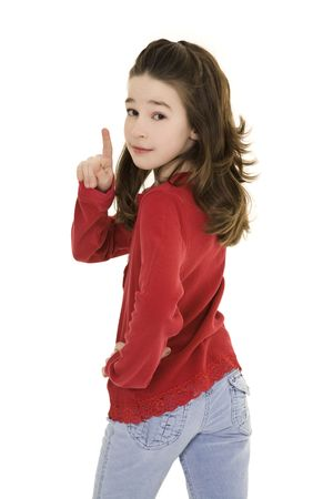 Caucasian preteen using her finger to display some attitude Stockfoto