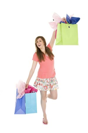 Beautiful Caucasian teenager holding shopping bags while standing on a white background Banco de Imagens - 3315309