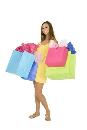 Beautiful Caucasian woman holding shopping bags while standing on a white background Banco de Imagens