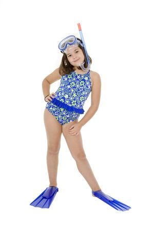 Caucasian child posing in a swimsuit standing on white