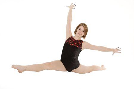 Caucasian teenage girl in gymnastic poses on white background 版權商用圖片 - 3927224