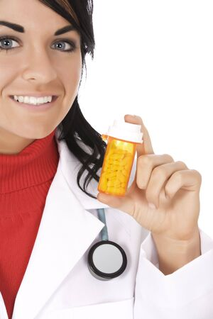 Caucasian doctor holding a bottle of pills 免版税图像