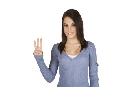 Beautiful Caucasian teenager counting on fingers on green background