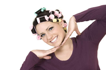 Beautiful Caucasian teenager with curlers Фото со стока - 4390674