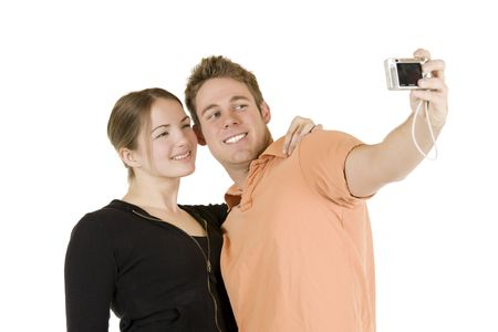 Young Caucasian couple taking a photo of themselfs Stock Photo