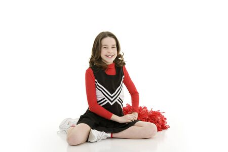 Ten year old caucasian girl dressed as cheerleader