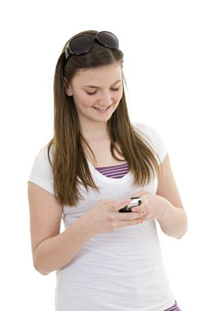 Caucasian teenager text messageing on white background Stock Photo