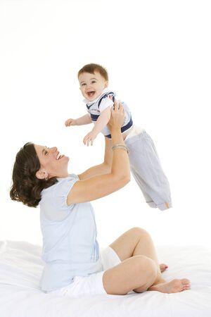 Beautiful Caucasian mother and baby boy  bonding