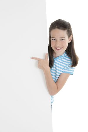 Cute Caucasian girl holding a blank sign Stockfoto