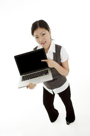 Beautiful Asian businesswoman holding and pointing at a laptop computer