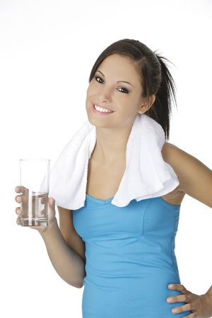 Cute Caucasian woman holding a glass of water on white background