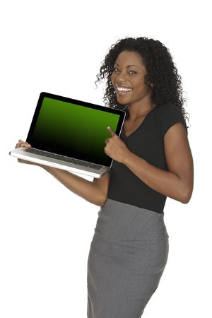 Beautiful African American businesswoman holding and pointing at a laptop computer  Stockfoto
