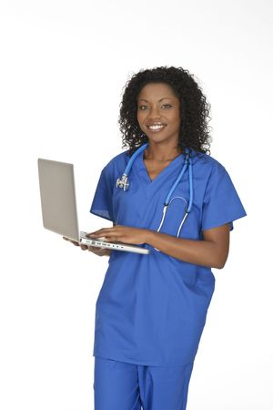 Beautiful African American doctor or nurse holding a laptop computer