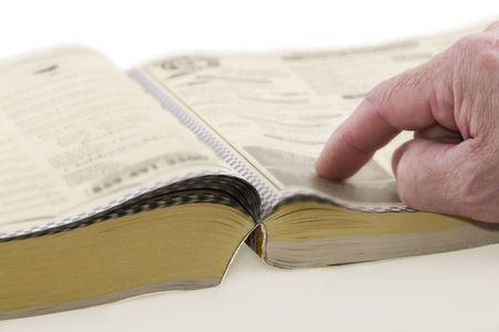 Somtimes książka telefoniczna zadzwonić na stronach żółty, kładzenia otwarte na tabeli