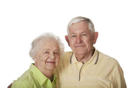 Happy elderly Caucasian couple posing on white background.