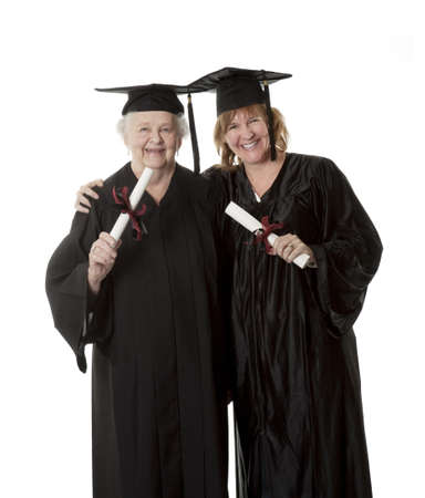 Beauitiful Caucasian woman in a black graduation gown Stock Photo