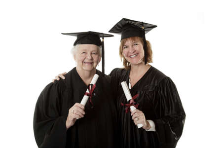 Beauitiful Caucasian mother and daughter in black graduation gown 免版税图像