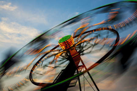 midway: Amusement Rides with Movement Blur in the evening at the Kentucky State Fair Midway Louisville Kentucky Stock Photo