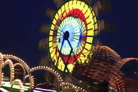 Amusement Rides with Movement Blur in the evening at the Kentucky State Fair Midway Louisville Kentucky photo