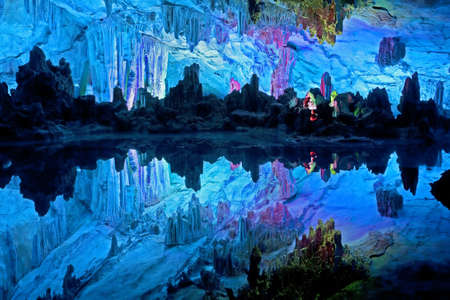 The beautifully illuminated Reed Flute Caves displaying the  Stock Photo