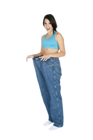 Woman showing weight loss by wearing an old pair of jeans Stock Photo - 8703041