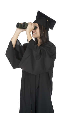 Beautiful Caucasian woman wearing in a black graduation gown and looking through binoculars Stock Photo - 8703054