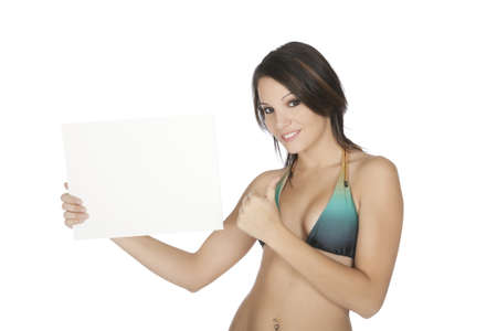 Sexy Caucasian woman wearing a bikini and holding a blank sign