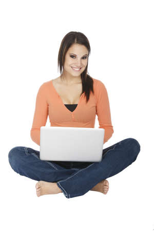 Attractive young girl using notebook computer on white background. Stock Photo - 8803561