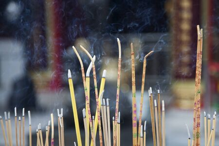 Incense left burning  by worshipers at Wong Tai Sin Temple  Also known as Sik Sik Yuen Wong Tai Sin Temple, is a Taoist Temple is located in Kowloon, Hong Kong, China Banco de Imagens