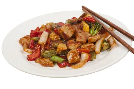 A delicious meal of Sweet and Sour Pork isolated on a white background with a clipping path