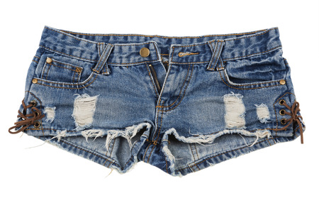 Old and worn blue jean shorts isolated on a white background