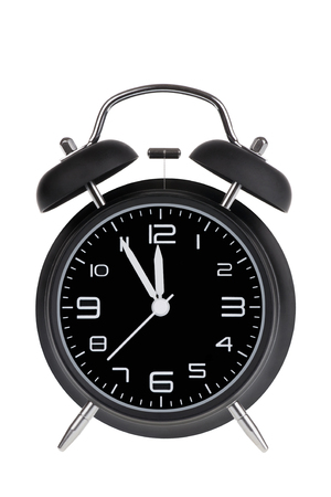Black Alarm Clock With The Hands At 5 Minutes Till 12 Illustrating