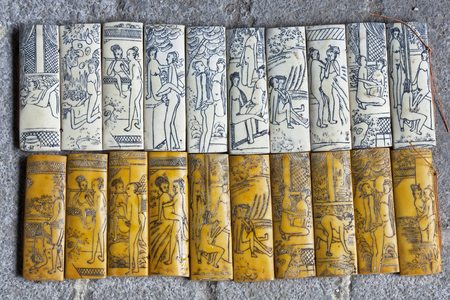 A souvenir bamboo carving showing the different kamasutra positions