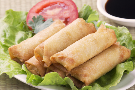 Traditional Chinese Spring Rolls with a dipping sause of soy sause Stock Photo