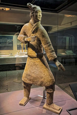 The famous Standing Archer unearthed in Pit 2 of the Terracotta Army.  Xian, Shaanxi province, China