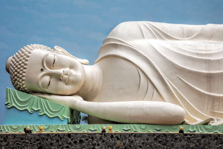 Reclining Buddha statue at the Vinh Trang Temple in Mytho City, Mekong Delta, Vietnam