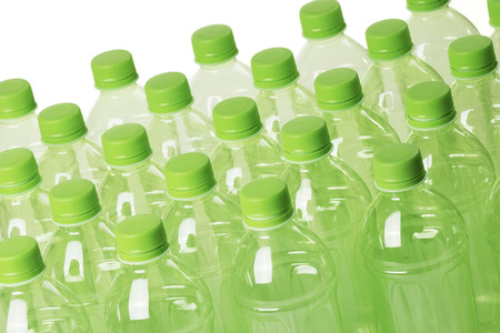 A collection of green plastic bottles isolated on a white background
