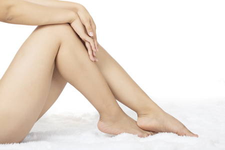 Woman's beautiful and sexy legs isolated on a white background