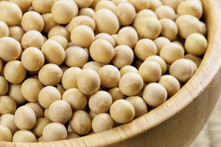 Close uo of a wooden bowl full of delicious soybeans